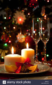 christmas decoration candles cinnamon sticks and pieces of
