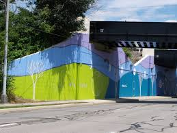 sunwall moonwall mural designs commissioned these murals mary rodgers the president of the organization was instrumental in making this project happen thank you mary rodgers