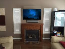 tv mounted over fireplace where to put cable box cool build a