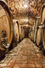 Wine Cellar Basement Rows Of Oak Barrels In Underground Wine Cellar Stock Photo