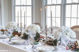 table settings white roses and magnolia leaves