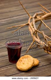 communion cracker crown of thorns with cup of wine and bread as symbols of communion