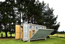 tiny container home complete with retractable deck by