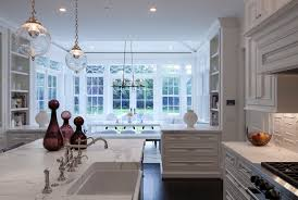 touchless kitchen faucet with recessed lighting ceiling bridge island