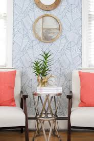 mid century modern chairs in the guest room graphic wallpaper