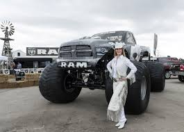 next monster truck show cowgirl dressed in white standing next to monster truck in texas