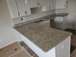 kitchen cabinets with light granite countertops moon light granite