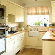 how to update your kitchen on a budget cream kitchen cabinets