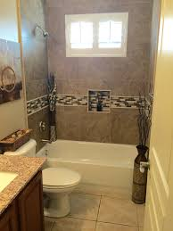 small bathroom with alcove bathtub shower combo and limestone wall