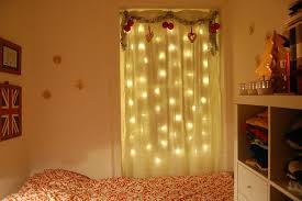 blue christmas lights in bedroom black fabric curtain white wooden