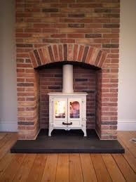 charming wood burning fireplace chimney design with white paint
