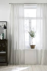 give your rooms a bright airy feeling with thin white curtains