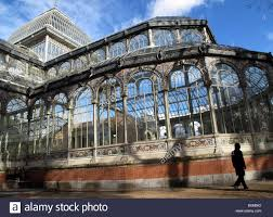 crystal palace glass pavilion in retiro park madrid spain stock