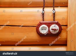 wood wall design electrical socket switch retro style on stock photo 690948655