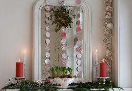 White Christmas Mantel Ideas by Red And White Christmas Mantel Display With Vintage French Mirror