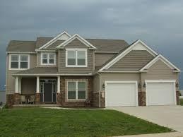 innovative house tan siding home designs