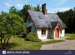 Small Cottage by Small Irish Cottage Situated In A Wooden Area Stock Photo Royalty