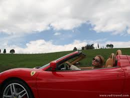 ferrary driving driving a 430 spider in tuscany italy on travel tour