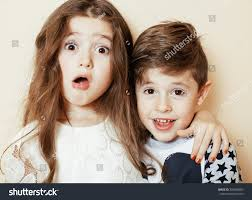 sister curls her brother hair little cute boy girl hugging playing stock photo 355088285