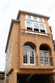 Three Story House by A Three Story House That Is Half Way Through Being Built Stock