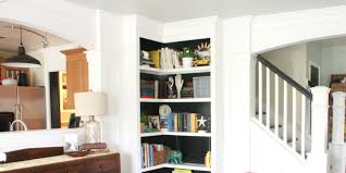 furniture white built in corner book cabinet havinf open shelf at