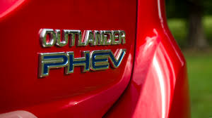 mitsubishi badge newmotoring the mitsubishi outlander phev a different kind of hybrid