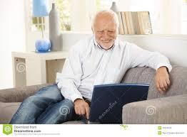 Man On Computer Meme - older man smiling at computer screen at home stock image image of