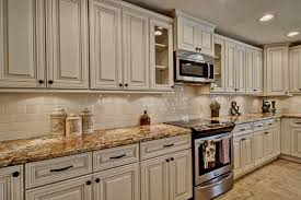 antique white kitchen cabinets with subway tile backsplash 41 ivory kitchen cabinets ideas kitchen remodel kitchen