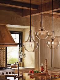 glamorous kichler lighting in kitchen farmhouse with clear glass pendants next to edison light fixture alongside single