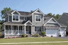 wraparound porch suburban home with wraparound porch stock photo lmphot 8711413