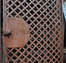 antique wrought iron gate or woven lattice garden trellis olde