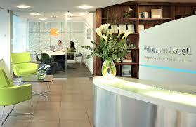 tech office design flowers on white pot in white receptionist desk for modern office