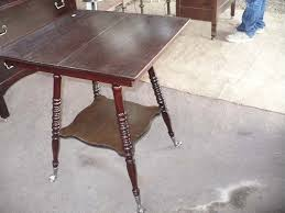 claw foot table with glass balls in the claw square wooden table home design ideas and pictures