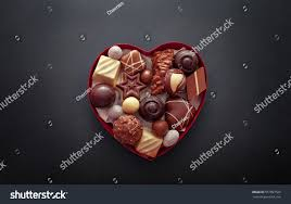 chocolates for s day chocolate pralines heart shape box day stock photo 557097565