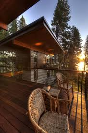 coeur d alene cabin blends lovely lake views with modern interiors view in gallery view of setting sun from the deck of coeur d alene lake house