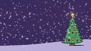 snow falling on a christmas tree tree lights ornaments twinkle