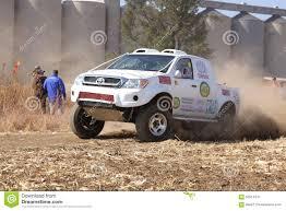 toyota trucks sa drifting white toyota truck kicking up dust on turn ar rally