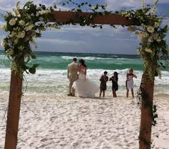 wedding arch log simple destin weddings