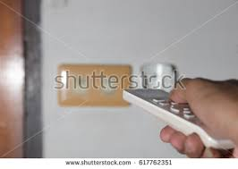remote to turn off lights people push remote control turn off stock photo royalty free
