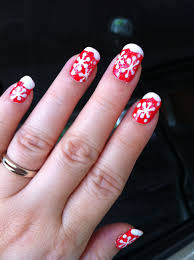 red nails with snowflakes french tip style for christmas