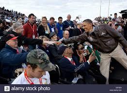 president barack obama greets veterans before the the start of the