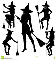 silhouettes of halloween witch standing with broomstick stock