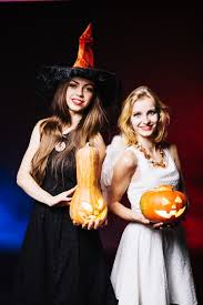 in costumes in costumes holding pumpkins photo free