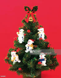 Decorations For Miniature Christmas Tree by Miniature Christmas Tree Decorated With Snowmen Figurines Stock