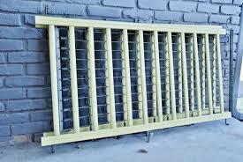 bathroom wall idea repurposed crib frame to bathroom wall decor hometalk