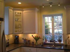 cool track lighting installation above the kitchen island track lighting over kitchen island amazing armless chair mixed