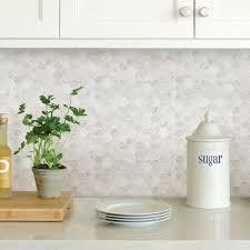 white kitchen cabinets with hexagon backsplash inhome white hexagon marble peel stick backsplash tiles