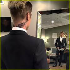 justin bieber gets wings on his neck see photos photo