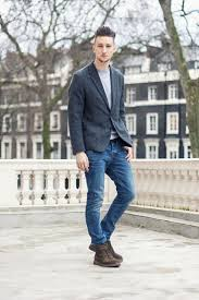 fashion trends dress boots with jeans mixed with dark grey suit