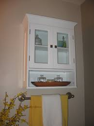 Bathroom Shelf Over Toilet by White Wooden Cabinet With Double Doors Also Shelf Floating On The